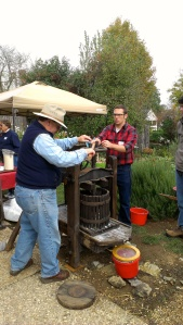 Picture of people pressing fresh apple cider