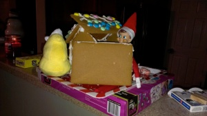 Silly elf hiding in the broken down gingerbread house. Engineering and architecture are not my strong suit.