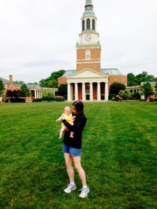 holding baby in front of Wait Chapel