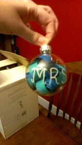 This one says Mr. & Mrs.  and their wedding date with curly paper in their wedding colors