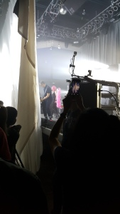 Performing behind the curtain