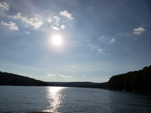 sun reflecting in lake